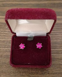 Ruby stud and gold earrings.Very pretty.