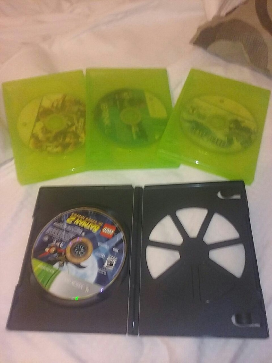 four XBOX game cases, used for sale  Pharr