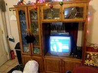 brown wooden TV hutch and boxtelevision 2280 mi