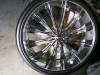 chrome multi-spoke car wheel with tire Tampa