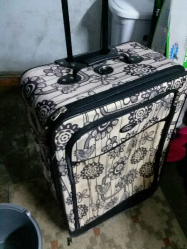 Flower wheeled suitcase