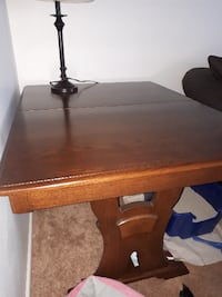 brown wooden table with black metal base TORONTO