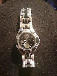 round silver chronograph watch with link bracelet Chicago, 60602