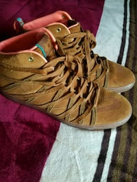 pair of brown leather high-top sneakers