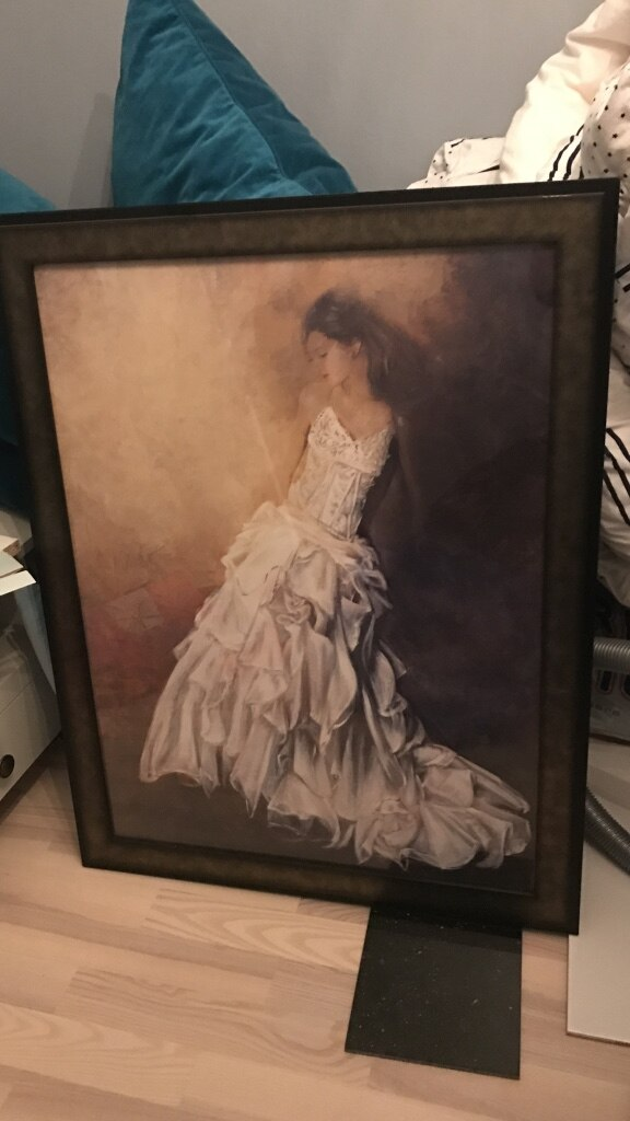 black framed woman in white gown artwork