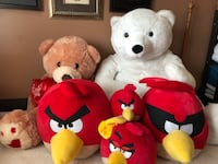 two red and white bear plush toys