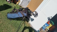 black and gray compound bow 556 km
