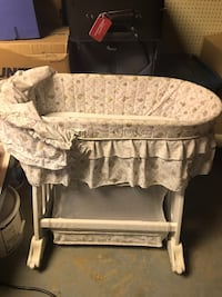 baby's white and gray bassinet Calgary, T2J 4A7