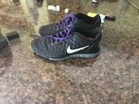 pair of black-and-white Nike running shoes London, N5W 2N2