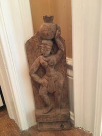 Wooden carved statue. Approx one foot high. Yes still available in Woodbridge. Vaughan, L4L 7J6