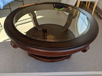 Large round coffee table solid wood and glass. . Oro Valley