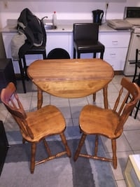 brown wooden table with four chairs