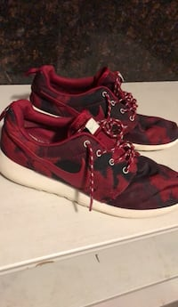pair of red-and-black Nike basketball shoes New York, 11203