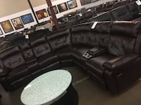 Bonded leather Reclining sectional with diamond stitching. Brand new.  Lewisville