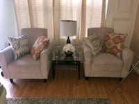 two brown wooden framed white padded armchairs Silver Spring