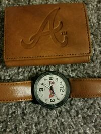 brown and white analog clock Jacksonville, 32216