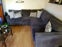 black suede sectional couch with throw pillows Huntington Beach