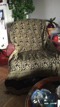 gray and brown floral fabric sofa chair