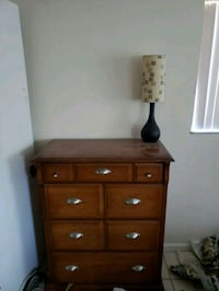 brown wooden 8-drawer tallboy dresser and black and beige table lamp Oakland Park, 33309