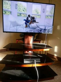 black flat screen TV with TV stand Silver Spring, 20906
