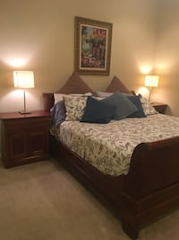 Brown wooden bed frame with white and black bed comforter Cedar Park, 20024