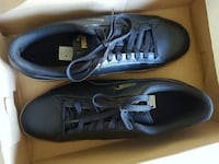 pair of black low-top sneakers Laval, H7N 2R6