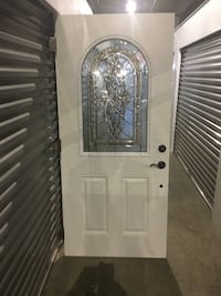 White entry door w arched lead glass and side light., briefly installed . Norwood, 02062
