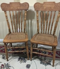Two heavy wood decorative chairs Columbus