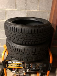 black vehicle tire set with text overlay Landing, 07850