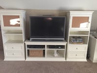 Two white wooden tv hutch with flat screen television Virginia Beach, 23457
