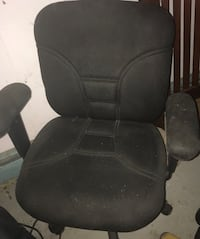 Black padded rolling armchair
