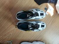 two pairs of white and black Nike basketball shoes Toronto