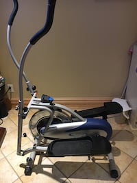 Gray and blue elliptical trainer 804 km