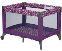 purple and pink floral travel cot 26 mi