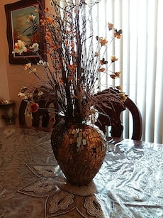 brown vase with plastic flower table decor