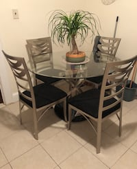 Circle glass top table with four chairs dining set North Arlington, 07031