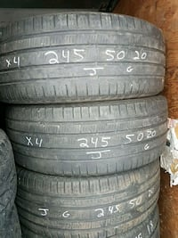 four black rubber car tires Calgary, T3G 5C8