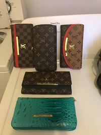 Black and brown leather Louis Vuitton wallet s Austell, 30168