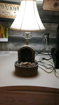 Table top lamp with running waterfall over rocks.