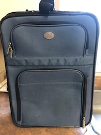 Carry on light blue luggage