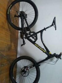 black and gray full-suspension bike 3731 km