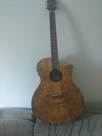brown and black dreadnought acoustic guitar Silver Spring, 20906