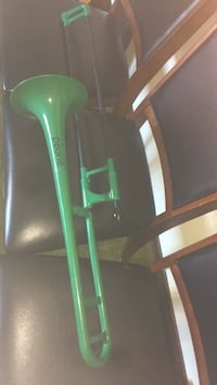 Trombone. Slightly used . With case . Musical instrument . Wind instrument. See similar at long mcquade or amazon 3737 km