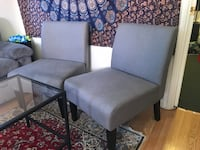 Two gray fabric padded side chairs