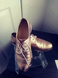 pair of brown leather dress shoes El Paso, 79912