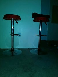 two brown wooden bar stools North Las Vegas, 89031