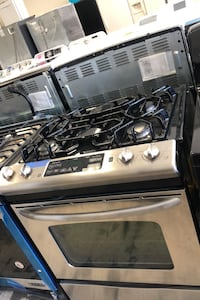 GE slide gas stove like new 4 months warranty