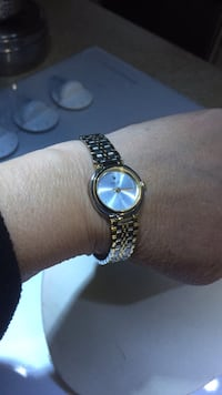 round silver-colored analog watch with link bracelet 3728 km