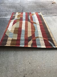 Rug, warm multi- colored  5 x 8 foot short shag rug