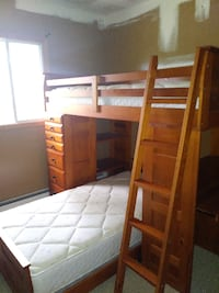 brown wooden bunk bed with mattresses CORAM